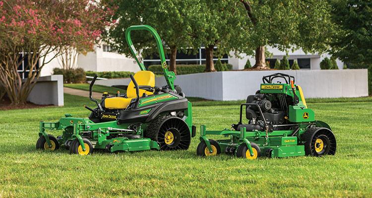 John Deere Z945M ZTrak and 636M QuickTrak mowers sitting on a freshly mowed lawn.